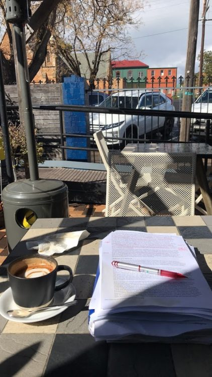 Photo from contributor of paper and pen at outdoor cafe