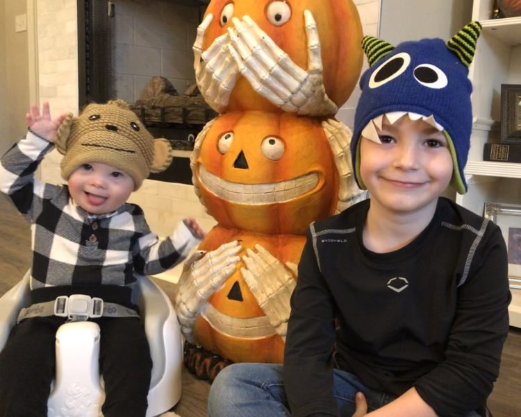 Ace and his brother with Halloween pumpkins.