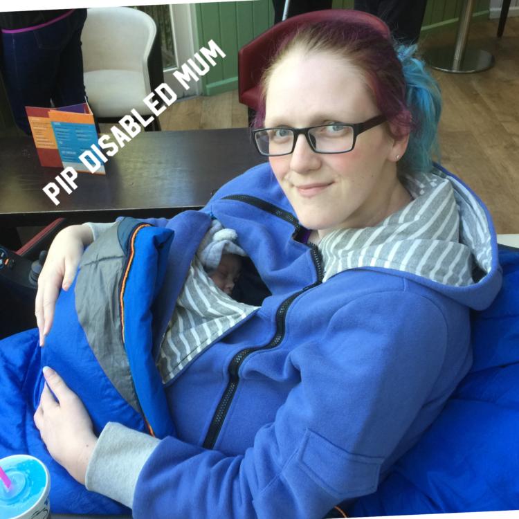 Pip holding her infant son.