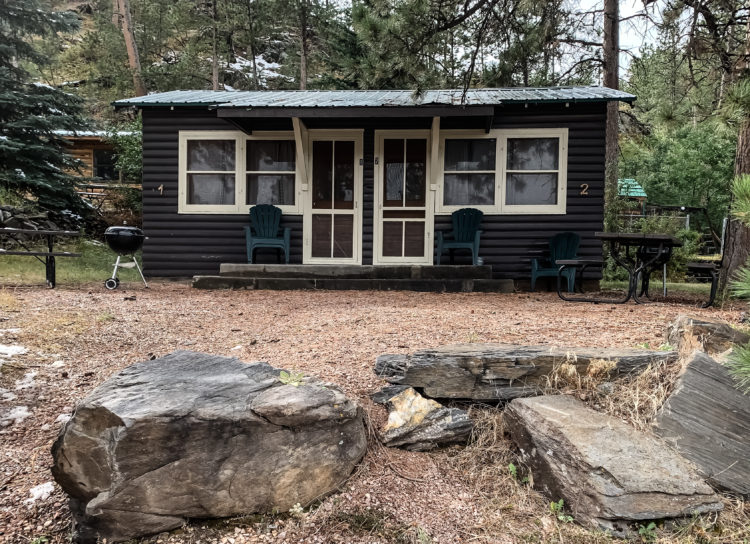 Photo of cabin in the woods