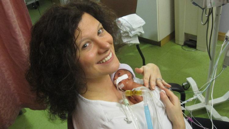 Jennifer holding her premature baby in the NICU.