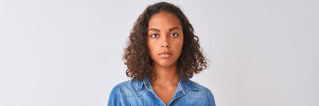 Young brazilian woman wearing denim shirt