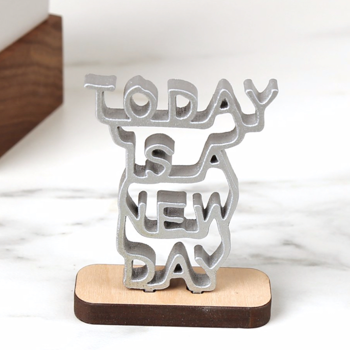 photo of a sculpture with the words Today Is a New Day