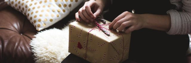 A woman opening a present