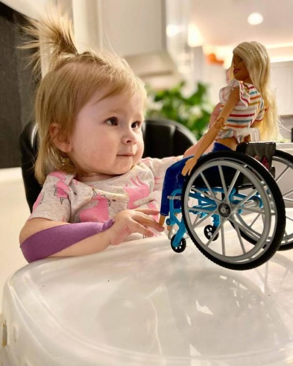 Stella with her Barbie that also uses a wheelchair.