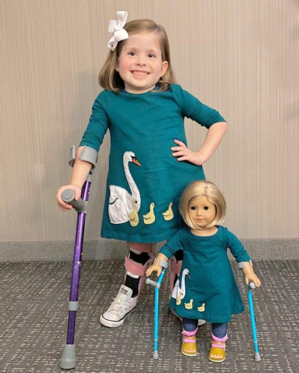 Eliza with her doll that also uses crutches.