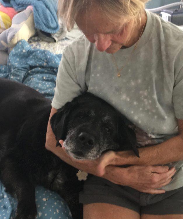 Ellen holds elderly Maggie.