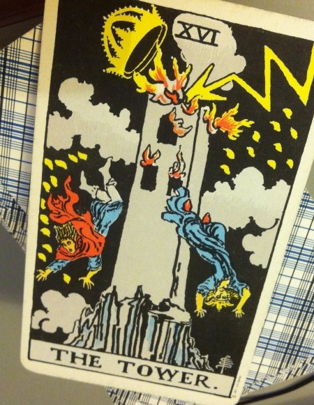 "Image of the tarot ""Tower"" card, which shows figures jumping out of a burning tower"