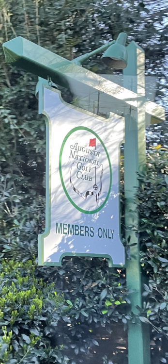 August National Golf Course sign, green hanging near trees
