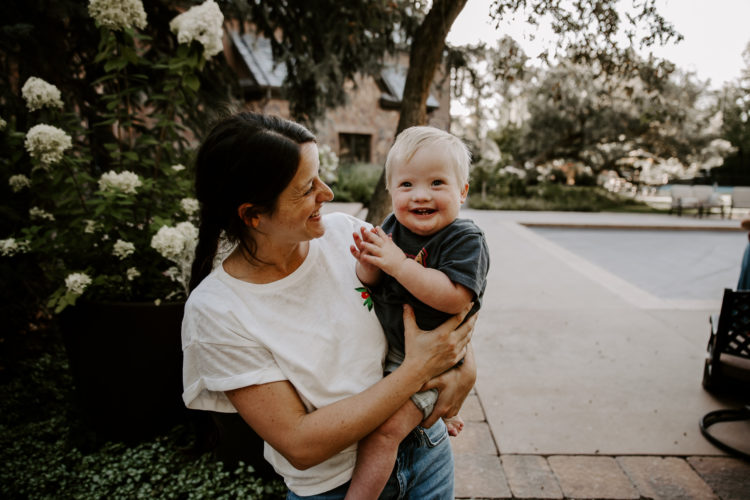 Madison holding her son.