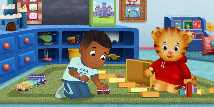 A scene from Daniel Tiger's Neighborhood with Max playing with toy cars