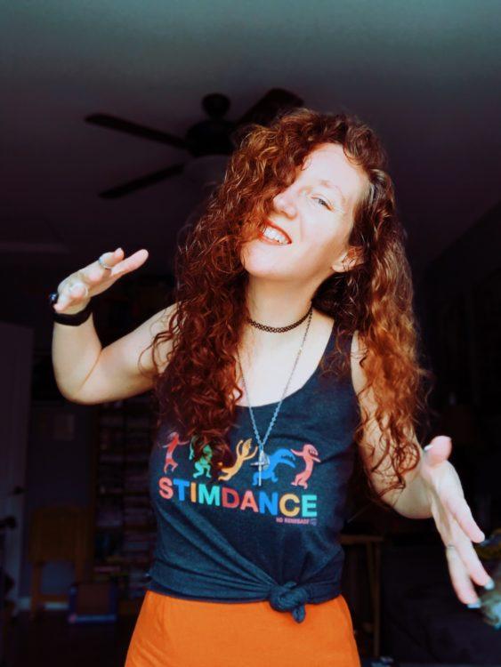 """Amelia wearing a """"Stimdance"""" t-shirt."""