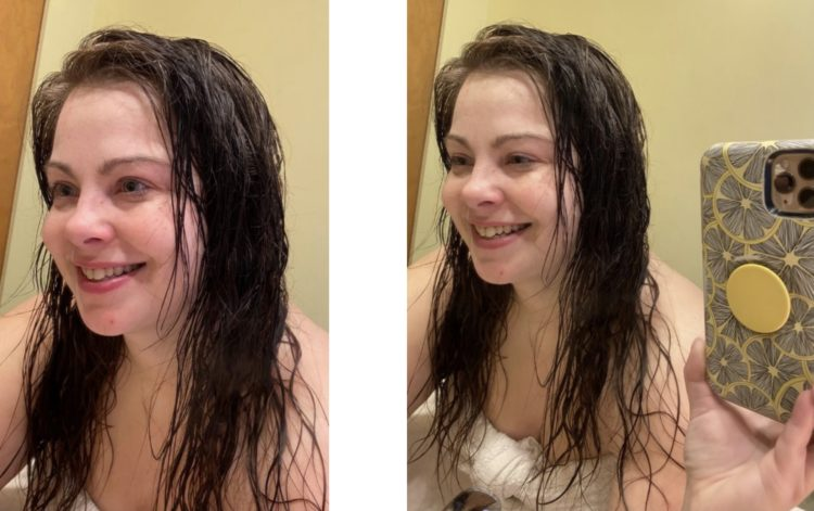 Author, young white woman with wet hair taking a mirror selfie, smile on left, bigger smile on right