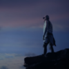 Man standing on a cliff looking at the sunset.